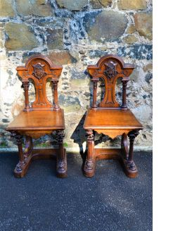 Pair of oak hall chairs