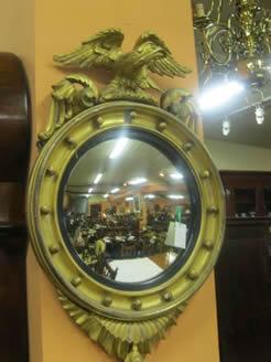 A regency giltwood convex mirror.