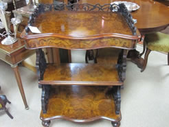 A victorian burr walnut wot-not