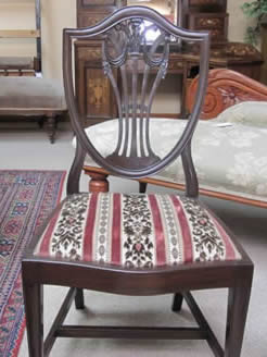 set of twelve mahogany dining chairs