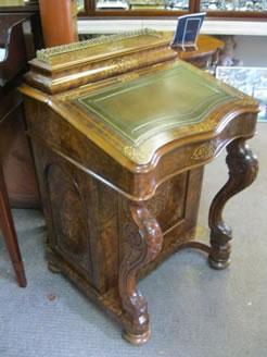 A victorian burr walnut davenport desk