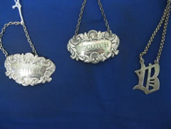 A selection of silver decanter labels
