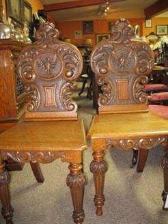 A pair of victorian hall chairs