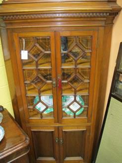 A 19th century mahogany corner cabinet