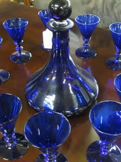 A set of 12 victorian bristol blue glasses and decanter