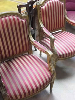 Pair of gilt armchairs