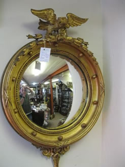 A regency gilt framed convex mirror