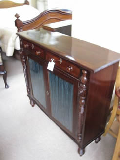 A regency mahogany side cabinet