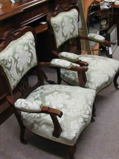 A pair of mahogany armchairs