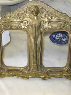 An art nouveau brass picture frame