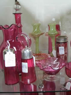 A large selection of victorian ruby and vaseline glass