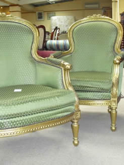 A pair of gilt wood armchairs.