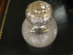 A silver topped perfume bottle