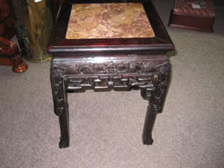 A chinese cherrywood plant stand