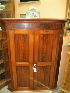 A 19th century corner hanging cabinet