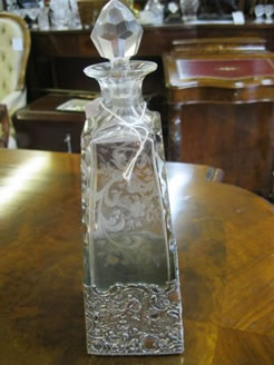 A sterling silver mounted decanter
