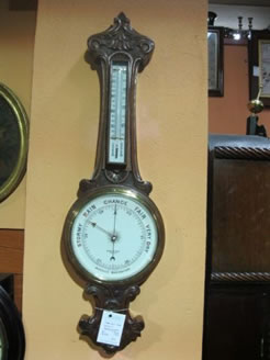 Carved oak cased barometer