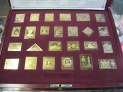 Cased  Silver Gilt Stamps
