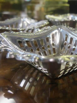 Set of four silver bon bon dishes