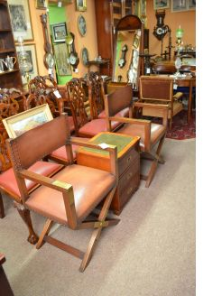 Pair of leather and brass mounted mahogany armchairs