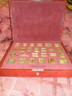 Cased empire collection gilt silver stamps