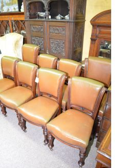 Set of eight victorian leather chairs