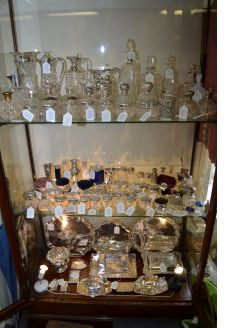 Large selection of antique perfume bottles etc in store