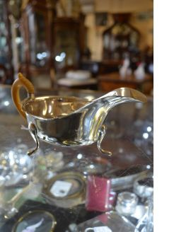 Silver sauce boat with ivory handle