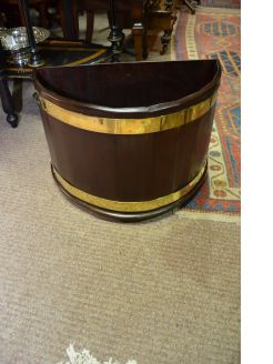 Georgian style mahogany and brass bound planter