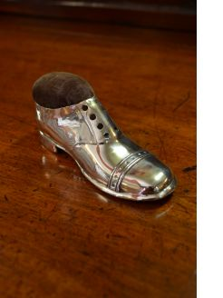 Silver boot pin cushion