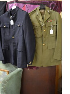 Selection of old military uniforms & hats