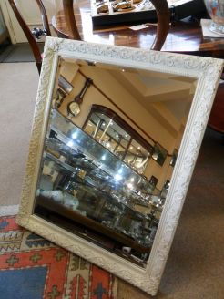 Old bevelled framed mirror