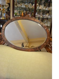 Large copper framed mirror
