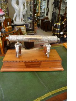 Indian silver scroll holder on wooden plinth