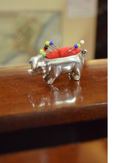 Silver pig pin cushion