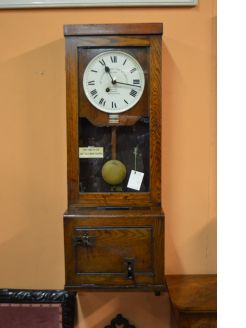 Oak cased time clock