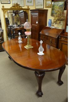 A mahogany two leaf dining table , circa 1910.