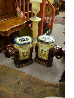 A pair of majolica elephant garden seats.
