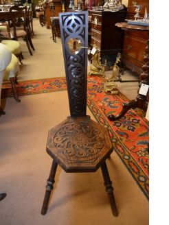 Carved oak spinning chair