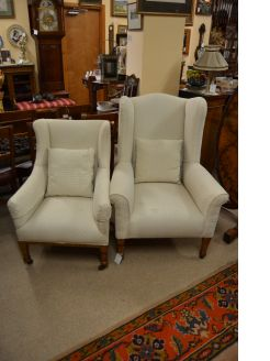 Two oak wingback arm chairs