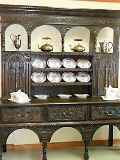 A Victorian carved oak dresser, circa 1860.