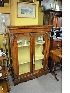 Victorian burr-walnut cabinet  with gilt metal mounts.