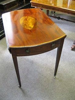 Georgian pembroke table, on brass castors, circa 1800