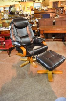Leather recliner armchair with foot stool