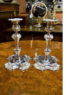 Pair of irish cast silver candlesticks