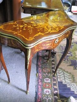 Small rosewood card-table with inlay and gilt