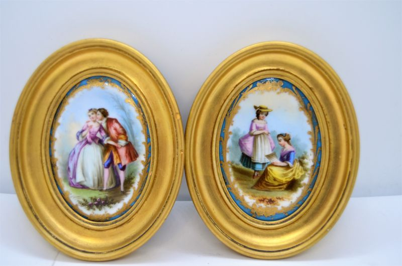 Pair of gilt framed painted porcelain panels