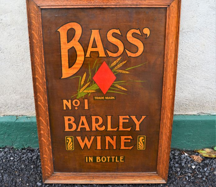Old wooden bass barley wine advertising sign