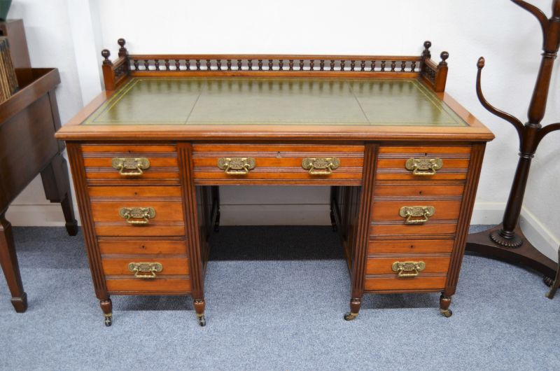 Victorian mahogany leather top desk with gallery surround