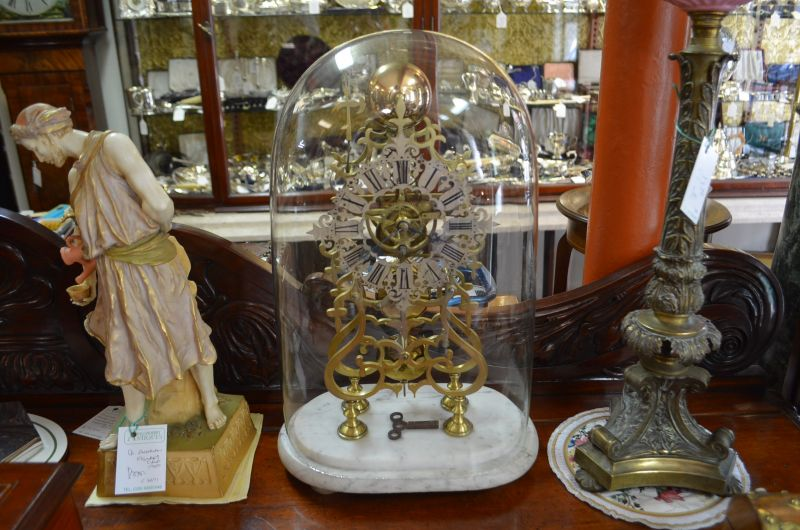 Victorian skeleton clock in glass dome and marble plinth